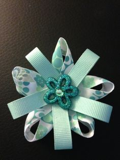 Teal flowers hair bow by MelBelleBoutique on Etsy, $5.00