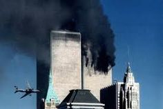 Flight 175 just before hitting the South Tower at 9.03 a.m., September 11, 2001. (Once again...how can photographers hold the camera steady?)