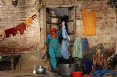 Pakistani woman washing clothes