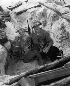 "From the Washington Post:  ""This photo from World War II's Battle of Peleliu is a favorite of former Vietnam dog handler Robert Kollar. To him there's something about the handler, Marine Cpl. William Scott, and his Doberman pinscher, Prince, that captures everything about the bond between wartime handler and dog. If you look at the photo and let it sink in, you can see what he means."""