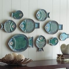 Malibu Fish Plates - use different shapes but mimic grouping idea...similar glaze and textures as well as shapes, pull it all together
