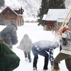 Having a snowball fight.From left to right: Colin, Ashley running away, Jim, and Susie