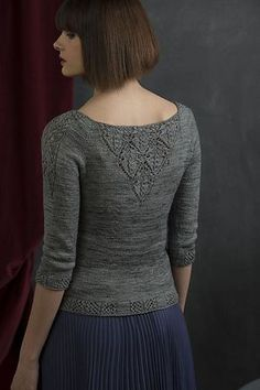 """… making the diamonds adjacent and altering the center stitches …forms a beautiful lace V down the center of the front and back of this lightweight pullover. Because the sleeves needed an elegant touch to match, I added a single column of lace v's—V for Victoria!"""