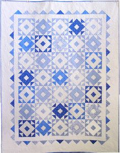 """""""Something Blue"""" pattern by Nancy Rink. A variety of soft blues and crisp white have classic appeal in this very traditional quilt."""