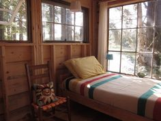 Lovely simple cabin. Abundant windows. Except they ought to be green-heat-keepin' ones.
