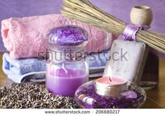 lavender spa accessories  with soap and candles by Donatella Tandelli, via Shutterstock