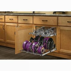 $116.99 · Revolutionize the way you store your pots, pans, and lids with Rev-A-Shelf's Two-Tier Pull Out Kitchenware Divider. The 5CW2 features independently operating shelves that accommodate a variety of cookware sizes and brands. The top tier organizes lids and the bottom tier features adjustable dividers to store a variety of larger pots and pans. Made with a heavy-duty chrome-plated wireframe and 100 lb. rated Full-extension ball bearing slides. What's Included? 2 Shelf/Shelves ..