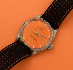 To continue our feature on vintage Rolex 'color dials', here is a new entry for today! This outstanding 1002 reference Oyster Perpetual manufactured in 1964 sports a 34mm wide, stainless steel case, a custom Orange dial, and applied steel rectangular markers. This timepiece is also equipped with an automatic caliber 1570 movement and a 19mm black/orange leather 'Racing' strap. (Store Inventory # 9688, listed at $3300). #rolex #orange #dial #racing #strap #oyster #perpetual #vintage #watch