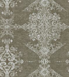 Arco Wallcovering A stunning non-woven wallcovering with great movement and texture. Featuring an ornate gothic design displayed in columns, printed in shades of taupe with metallic silver highlights.
