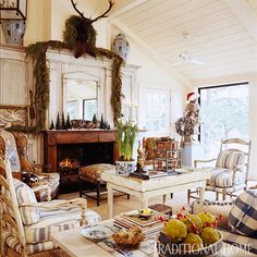 vintage and rustic - love the antiqued finish on the walls and ceiling, that fabulous mantel, the eclectic collection of furniture and the sleeping pup by the fire.  Oh and the Santa hat on the statue is adorable!