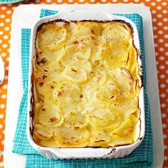 Simple Au Gratin Potatoes Recipe -These super cheesy potatoes au gratin are always welcome at our dinner table, and they're so simple to make. A perfect complement to ham, this homey side dish also goes well with pork, chicken and other entrees. —Cris O'Brien, Virginia Beach, Virginia