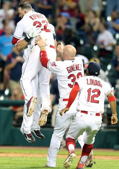 Cleveland Indians Yan Gomes celebrates with Jason Kipnis, Chris Gimenez and Francisco Lindor after knocking in Lonnie Chisenhall with the winning run in the 11th inning against the Texas Rangers at Progressive Field on June 1, 2016.   Indians won 5-4.  (Chuck Crow/The Plain Dealer)
