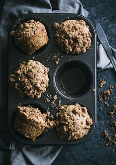 Whole wheat zucchini muffins made lighter and topped with a cinnamon crumble | thealmondeater.com