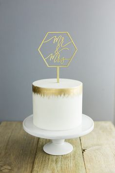 Mr & Mrs Geometric Laser Cut Gold Wedding Cake by LettersToYou