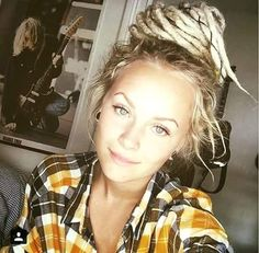 This is a lovely profile photo with dreads updo.