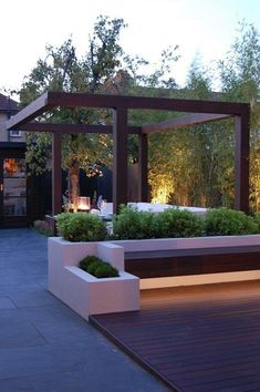 built in seating. lighting and structure to define various parts of the garden