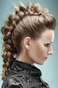 This is a great dutch braid that I think I'll do some day soon. I love the faux hawk look and this is great way to incorporate both styles in one look.