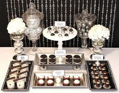 black and white and silver dessert table