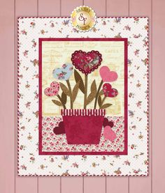 Sweetheart Bouquet Wall Hanging Pattern: This wall hanging was designed by Jennifer Bosworth of Shabby Fabrics, and combines two of our favorite things: hearts and flowers! Create this darling wall hanging for someone you love, or display it in your own home. This pattern includes all instructions for the 22