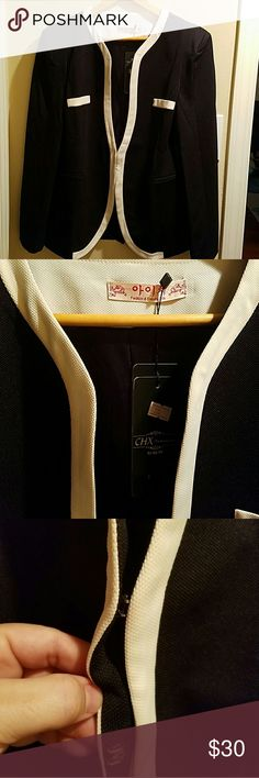 Black & White Blazer It's NWT very flattering. It is a Chinese brand but it is made very well. It is lined but would still be comfortable in warmer climates. It's a very flattering shape. Jackets & Coats Blazers