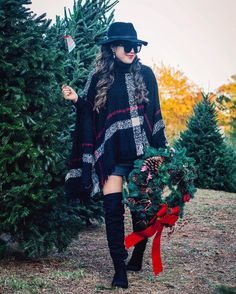 "One of my favorite things to do is to visit the Christmas tree farms and pick out a . And by pick out a tree I mean... deciding which one captures the best light to shoot by. // shop my #holidaylook by ""liking"" this photo. My poncho is under $30! http://liketk.it/2pHTl @liketoknow.it"