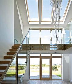 double height hallway atrium with light fitting with 33 hand-blown glass icicle
