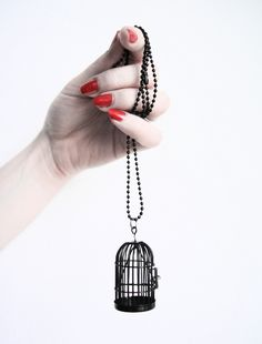 Dramatic bird cage necklace by Kooky Gems.