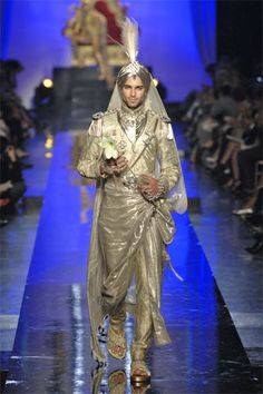 Jean Paul Gaultier Fall 07 Couture though it is around the model's waist it resembles a palla that would be draped like a scarf over a tunic