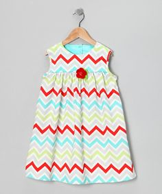With a prim chevron pattern and babydoll silhouette, this dress leaves a trail of sweetness in its tracks. Durable cotton and back button closures make it just as sweet to put on.100% cottonMachine wash; tumble dryMade in the USA