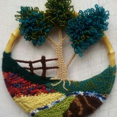 handcrafted crocheted image of circular landscape
