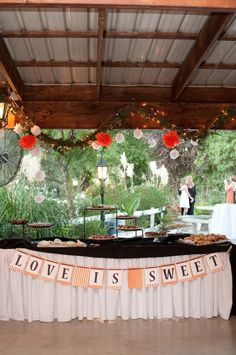 Love is sweet and this is a super cute idea for a desert table.