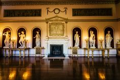"""Illustrating Robert Adam's intention to """"parade the conveniences and the social pleasures of life"""", every aspect of the State Dining Room with its ornate Corinthian columns and marble statues of Ceres and Bacchus representing food and drink, offers the experience and enjoyment of entertaining on a grand scale. Above the imposing fireplace designed by Joseph Rose, is a marble panel by Luc-Francois Breton of the Three Graces, the daughters of Zeus. The fine clock in the corner of the room was…"""