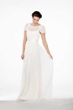 CH6300 l A sheer illusion dress with a low plunge back and flutter sleeves that drape and frame perfectly around the shoulders. This simple, modern wedding dress showcases the collarbones and neckline of the bride beautifully. #sajawedding