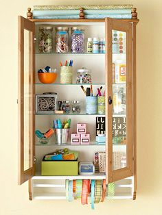 """Hanging Craft Organizer - A shallow hanging cupboard provides plenty of storage for small items, such as crafts supplies. Hang one cupboard, or a pair, wherever more put-away space is needed. Add finials to the top to corral wrapping paper and thread spools of ribbon onto a tension rod beneath the cupboard."""