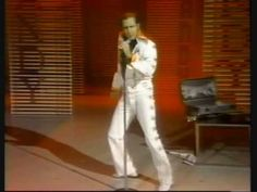 "Andy becomes Elvis at"" The Andy Kaufman Special"" (also known as ""Andy's Funhouse""). it was shot in July 1977. (before Elvis died).  Andy was the first person who did Elvis impersonation on TV in the 70s. He was also Elvis' own favourite.    R.I.P. Andy 1949-1984"