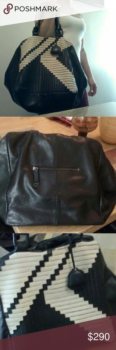 L.A.M.B. XL Leather Bag Excellent condition! This bag is super big, very nice and high quality leather! Cream and black. It's just a little too big for me right now. L.A.M.B. Bags Hobos