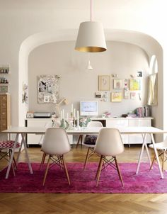 Modern dining with pink rug