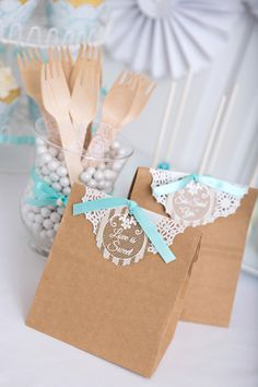 lace accented favor bags http://www.weddingchicks.com/2013/09/04/blue-and-white-cake-table/
