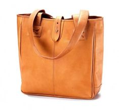 Classic styling makes this leather tote great for anyone and anything Comes in 3 great colors of black cafe rich brown and tan Fully lined interior wi