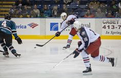 Worcester Sharks defenseman Taylor Doherty attempts to block a shot by a Springfield Falcons player (Oct. 13, 2013).