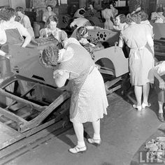 Willys Overland Factory Toledo, Ohio (1942)  Women building military jeeps ~ while wearing dresses!