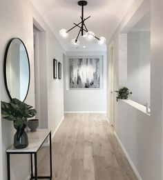 A wide entry all the way. Love the contrast of the light flooring and black accents in this gorgeous home of Builder: modern hallway Hallway Flooring, Hallway Wall Decor, Entry Hallway, Hallway Lamp, Contemporary Hallway, Modern Hallway, Contemporary Interior, Entrance Lighting, Entrance Decor