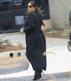 Fashionable arrival: As she arrived at the building earlier she sported a long wool jacket and designer shades