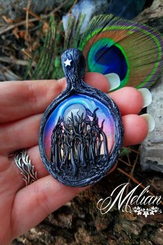 Beautiful Black Forest pendant, with tall trees, night sky and full moon rising behind them. Handmade from top quality polymer clay, with lots of details, and beautiful Moonstone. As forest lovers know, there is nothing more beautiful than the full moon shining above the woods. Now you can take this beautiful scene anywhere with you.  #MelianArt #BlackForest #Handmade #MoonstoneJewelry #ForestJewelry #WiccaNecklace #DarkForest #MagicAmulet