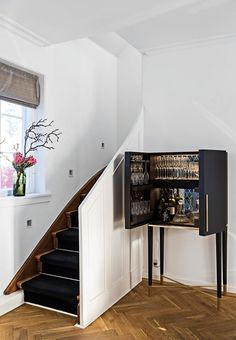 Small staircase leading up to the house' first floor. We love the elegant bar cabinet.