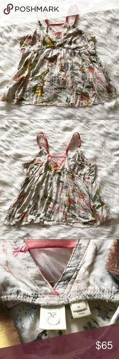 "RARE Anthropologie Eloise Flora and Fauna Cami Anthropologie / Eloise Flora and Fauna Cami. Deep v in the front and back with a lattice / cutout design. Cream colored Cami with an eccentric animal, floral, fruit, & script print. Peacocks, peels, lemons, kittens, and so many more fun prints! Adjustable straps w/ metal hardware (there are some greenish marks from the metal on the straps.) Size medium. Great condition! As seen on TV! The Vampire Diaries Season 6 episode 3  ""Welcome to…"