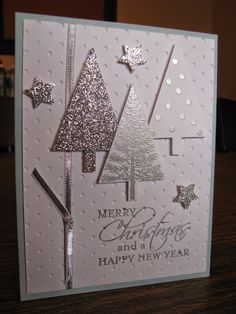 SU! Festival of Trees stamp set, Tree punch, silver embossing powder, silver glimmer paper, Soft Sky card base - Reta Daugherty