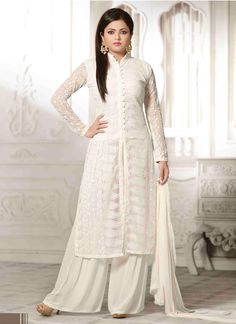 This season your look gets better definition with just a little attention to detail. Create a smoldering impact by this white net designer palazzo salwar kameez. This ravishing attire is amazingly emb...