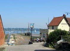 Pin Mill sits beside the River Orwell, south east of Ipswich, a pretty refuge of yachts and dinghys, where X marks the spot at the crossroads of a figure-of-eight walk. Bury St Edmunds, England Uk, Live In The Now, Seaside, Countryside, Ireland, River, Holidays, Beach