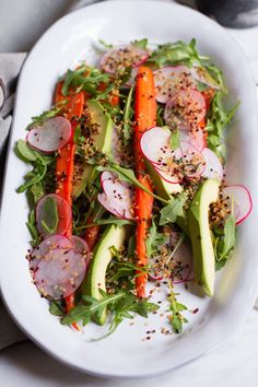 Roasted Cumin Carrot, Radish, Avocado Salad | http://saltandwind.com
